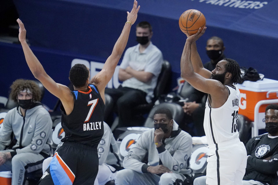 Photo - Brooklyn Nets guard James Harden (13) shoots as Oklahoma City Thunder forward Darius Bazley (7) defends in the first half of an NBA basketball game Friday, Jan. 29, 2021, in Oklahoma City. (AP Photo/Sue Ogrocki)