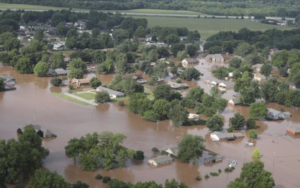 Photo - Homes are flooded near South 145th West Ave. near Oklahoma 51 on the Arkansas River on Friday, May 24, 2019, in Tulsa, Okla. (Tom Gilbert/Tulsa World via AP)