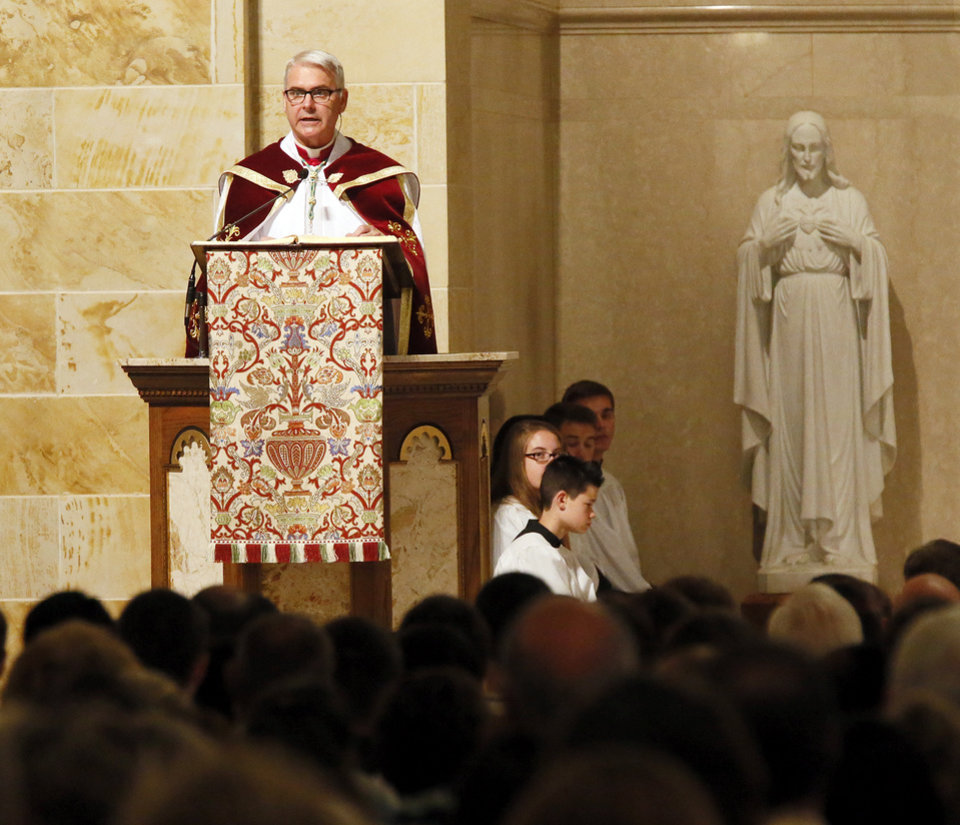 "Photo - Archbishop Paul S. Coakley gives his homily during the Eucharistic Holy Hour with Procession and Benediction by the Archdiocese of Oklahoma City at Saint Francis of Assisi Catholic Church, 1901 NW 18, in Oklahoma City, Sunday, Sept. 21, 2014. The event was held in response to the ""black mass"" being held at the Civic Center Music Hall. Photo by Nate Billings, The Oklahoman"