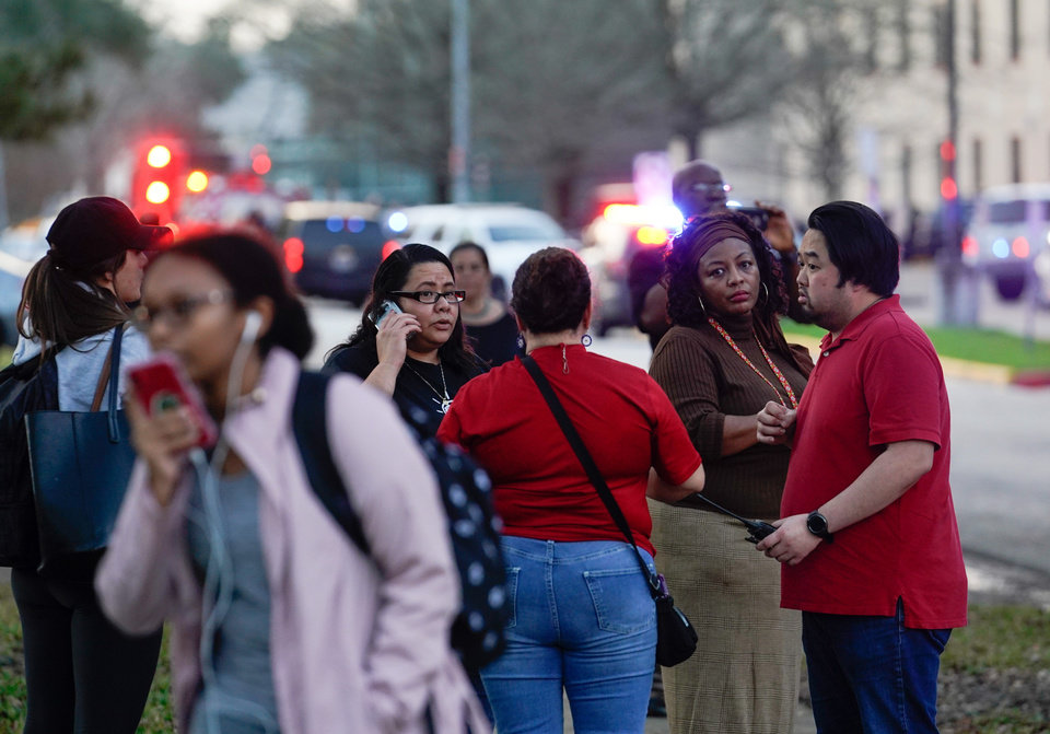 Photo - People wait outside Bellaire High School after a shooting, Tuesday, Jan. 14, 2020, in Bellaire, Texas. (Melissa Phillip/Houston Chronicle via AP)