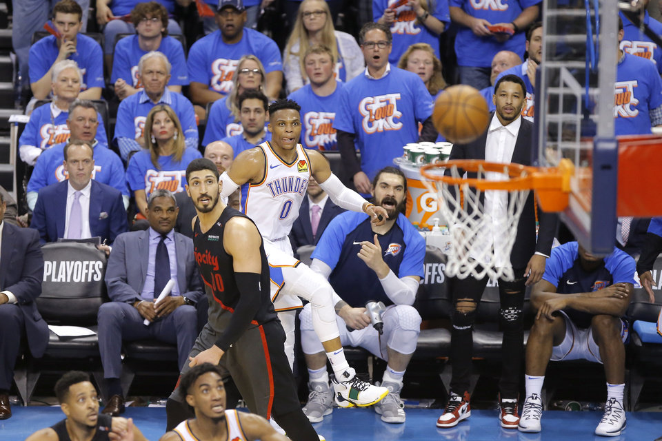 Photo - Oklahoma City's Russell Westbrook (0) watches his shot bounce off the rim beside Portland's Enes Kanter (00) during Game 4 in the first round of the NBA playoffs between the Portland Trail Blazers and the Oklahoma City Thunder at Chesapeake Energy Arena in Oklahoma City, Sunday, April 21, 2019. Portland won 11-98.  Photo by Bryan Terry, The Oklahoman