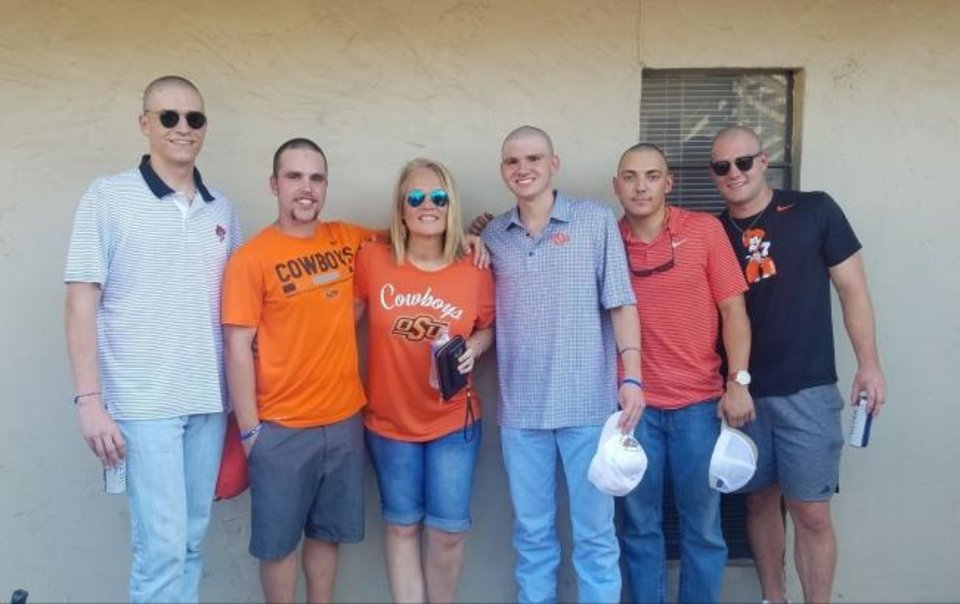 Photo -  Penny Martin, who is Oklahoma State defensive end Brock Martin's mom, is pictured with five former Oologah athletes and students who have shaved their head in support of her battle with cancer. From left, Cooper Young, Carson Keeter, Karson Davis, Cole Dunbar and Gunter Pearson. [Photo provided]