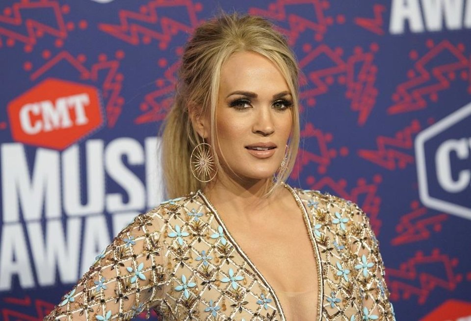 Photo - Carrie Underwood arrives at the CMT Music Awards on Wednesday, June 5, 2019, at the Bridgestone Arena in Nashville, Tenn. [AP Photo/Sanford Myers]