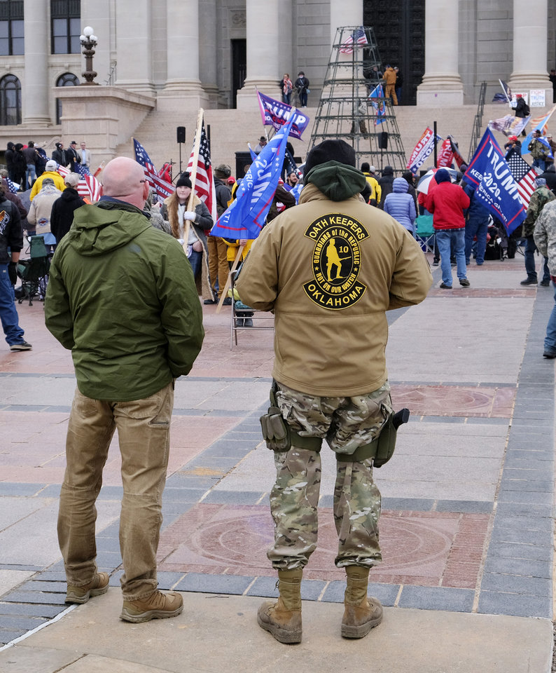 Photo - A member of Oath Keepers stands at the back. Supporters of Pres. Donald Trump gathered at the Drive for 45 rally on the south plaza at the Capitol Wednesday, January 6, 2021. [Doug Hoke/The Oklahoman]