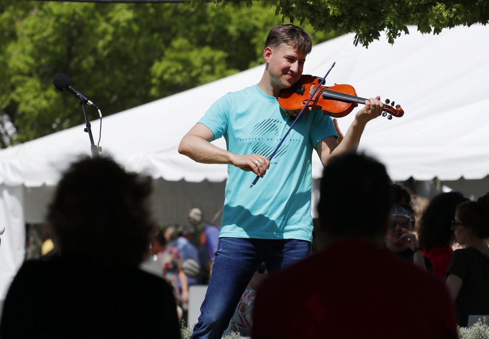Photo - Peter Markes plays during Art Moves on the Colcord Lawn at the Festival of the Arts in Bicentennial Park in downtown Oklahoma City, Sunday, April 28, 2019. He will perform Sunday during the Scissortail Park grand opening weekend. [Doug Hoke/The Oklahoman Archives]