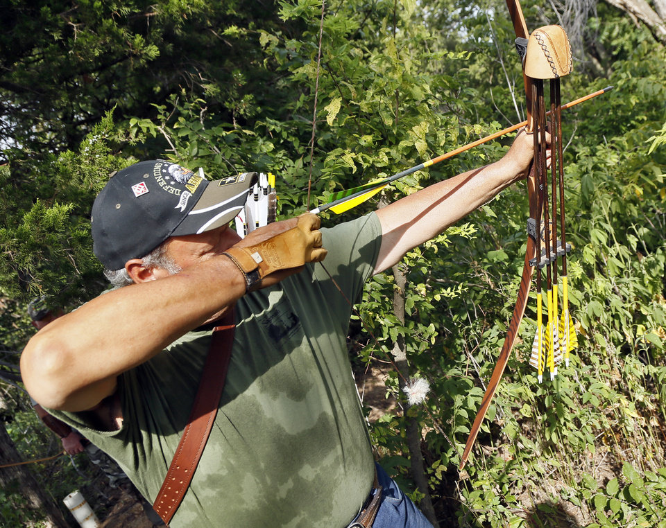 Photo -  Bowhunters like Johnny Pappan prefer to use traditional archery equipment when hunting for the challenge it provided. [PHOTO BY NATE BILLINGS, THE OKLAHOMAN]