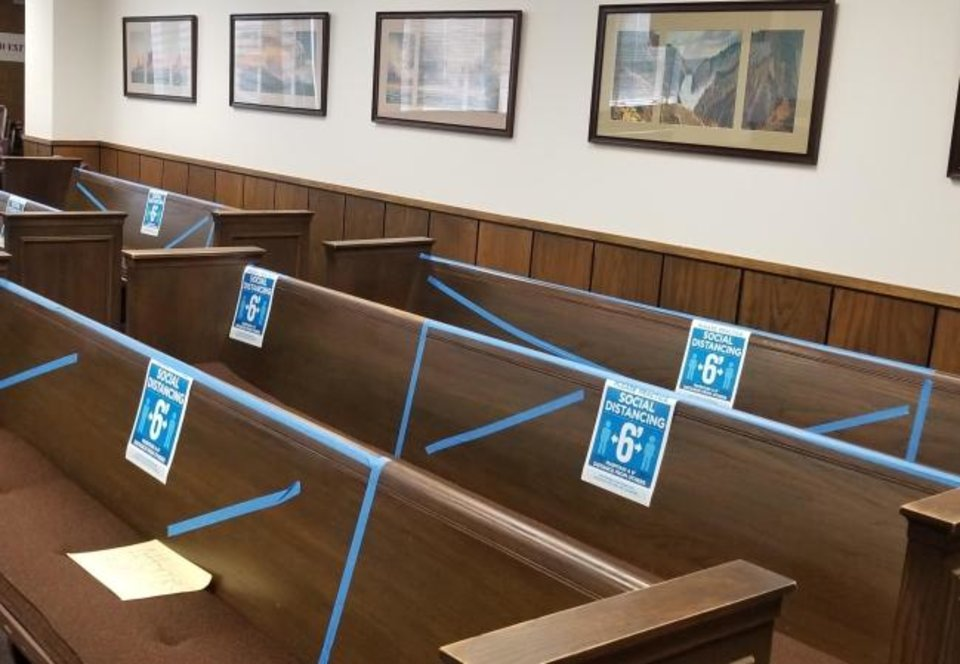 Photo -  Tape and signs designates where in-person hearing participants at the Oklahoma Corporation Commission will be allowed to sit. Each person will be assigned a spot, officials say. [PROVIDED/OKLAHOMA CORPORATION COMMISSION]