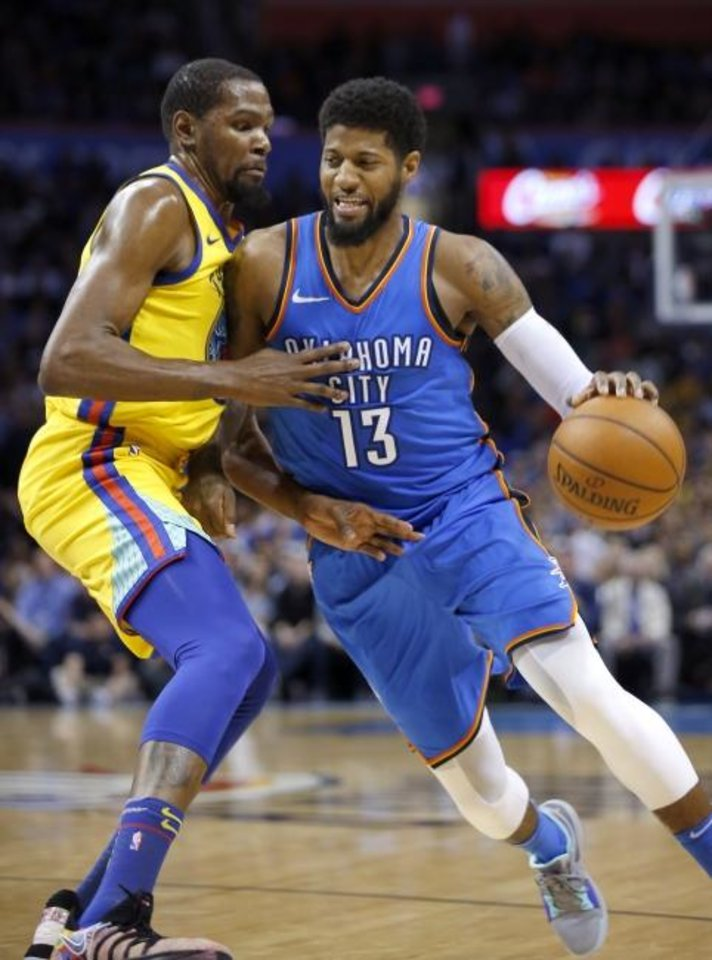 Photo - Oklahoma City's Paul George (13) tries to get by Golden State's Kevin Durant (35) during the NBA basketball game between the Oklahoma City Thunder and the Golden State Warriors at the Chesapeake Energy Arena,  Tuesday, April 3, 2018. Photo by Sarah Phipps, The Oklahoman