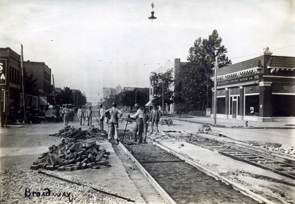 Photo -  This undated photo shows trolley tracks being installed along Broadway and NW 6 as indicated by recorded addresses for businesses shown. This photo is one of more than two dozen not seen by the public until it was recently acquired by the Oklahoma Historical Society. [Oklahoma Historical Society]