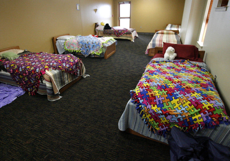 Photo -  Colorful blankets cover beds in a common bedroom at the Laura Dester Shelter in Tulsa. [MATT BARNARD/Tulsa World]
