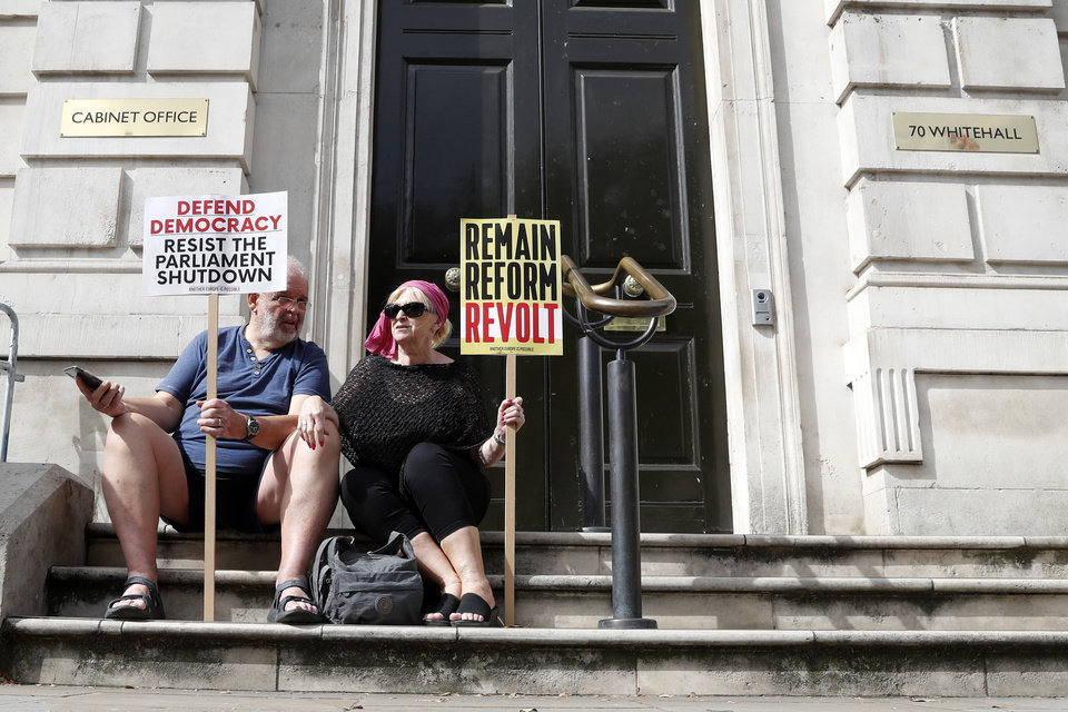 Photo -  Anti-Brexit protesters from 'Stop the Coup' movement demonstrate near Downing Street in London, Saturday, Aug. 31, 2019. Political opposition to Prime Minister Boris Johnson's move to suspend Parliament is crystalizing, with protests around Britain and a petition to block the move gaining more than 1 million signatures. (AP Photo/Alastair Grant)
