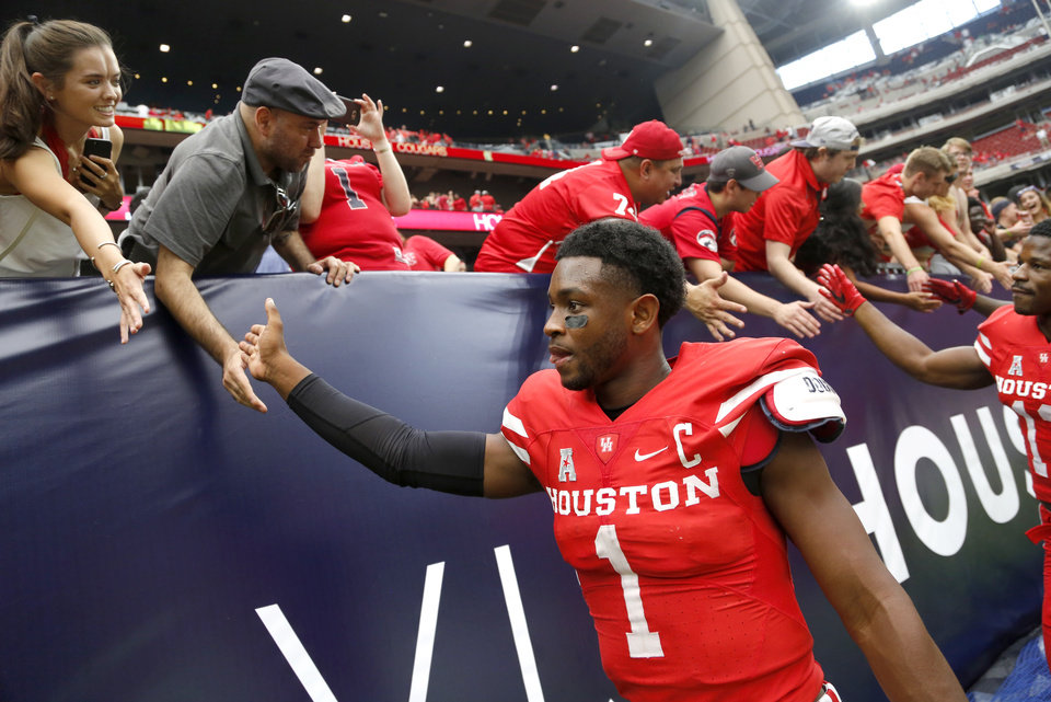 Photo - Houston quarterback Greg Ward Jr. celebrates with fans after the AdvoCare Texas Kickoff college football game between the Cougars and Oklahoma Sooners on Saturday at NRG Stadium in Houston. (Photo by Bryan Terry, The Oklahoman)