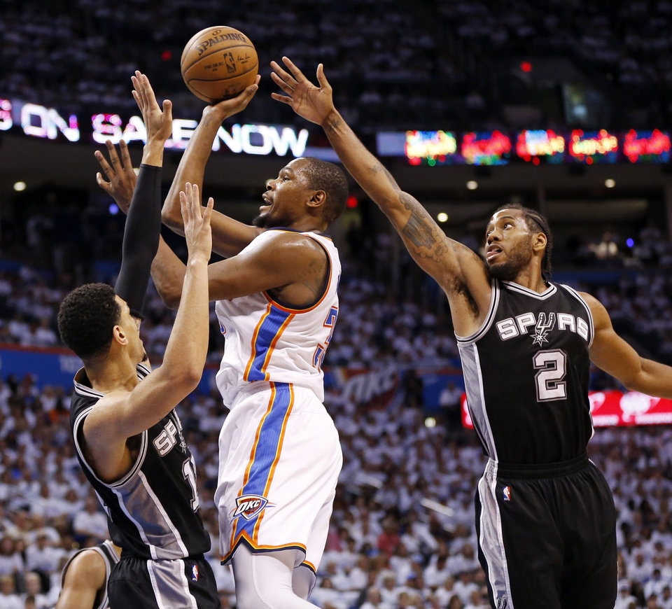 Photo - Oklahoma City's Kevin Durant (35) shoot between San Antonio's Danny Green (14) and Kawhi Leonard (2) in the third quarter during Game 4 of the Western Conference semifinals between the Oklahoma City Thunder and the San Antonio Spurs in the NBA playoffs at Chesapeake Energy Arena in Oklahoma City, Sunday, May 8, 2016. Oklahoma City won 111-97. Photo by Nate Billings, The Oklahoman