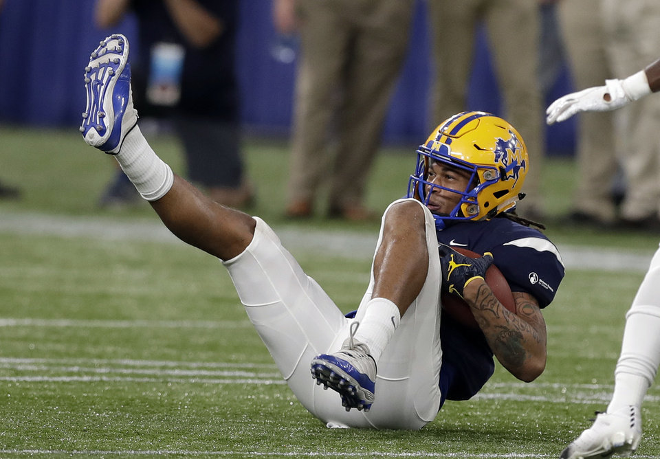 Photo - West linebacker Bj Blunt (18), of McNeese State, intercepts a pass by the East during the second half of the East-West Shrine football game Saturday, Jan. 19, 2019, in St. Petersburg, Fla. (AP Photo/Chris O'Meara)