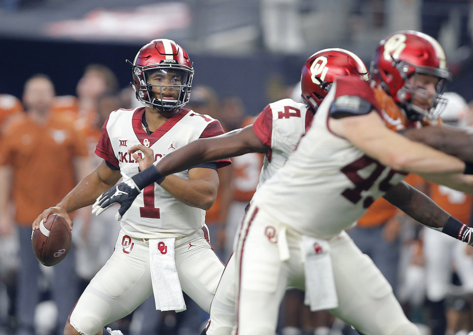 Photo - Oklahoma's Kyler Murray (1) drops back to pass during the Big 12 Championship football game between the Oklahoma Sooners (OU) and the Texas Longhorns (UT) at AT&T Stadium in Arlington, Texas, Saturday, Dec. 1, 2018.  Oklahoma won 39-27. Photo by Bryan Terry, The Oklahoman