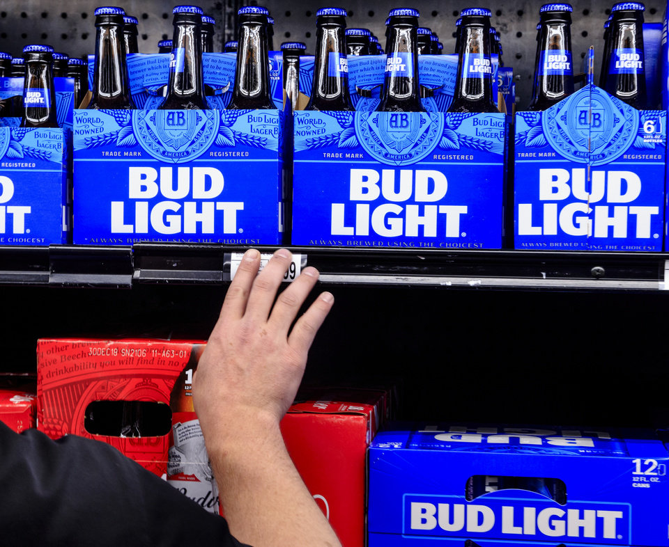 Photo - Beer reps stock the shelves with high point beer in preparations for sales to begin on Oct. 1st. at the Homeland store located at Britton Rd. and May Ave. in Oklahoma City, Okla. on Wednesday, Sept. 26, 2018. Photo by Chris Landsberger, The Oklahoman