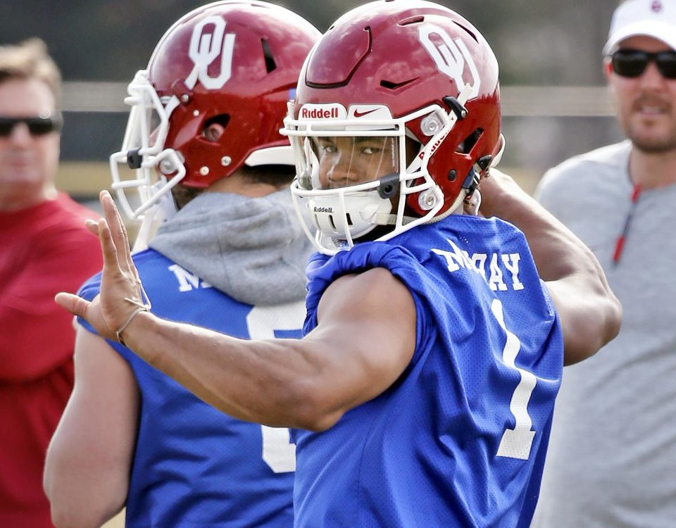 Photo - Quarterback Kyler Murray throws as the University of Oklahoma Sooner (OU) football team begins spring practice at the rugby fields on south campus in Norman, Okla., on Tuesday, March 21, 2017. Photo by Steve Sisney, The Oklahoman