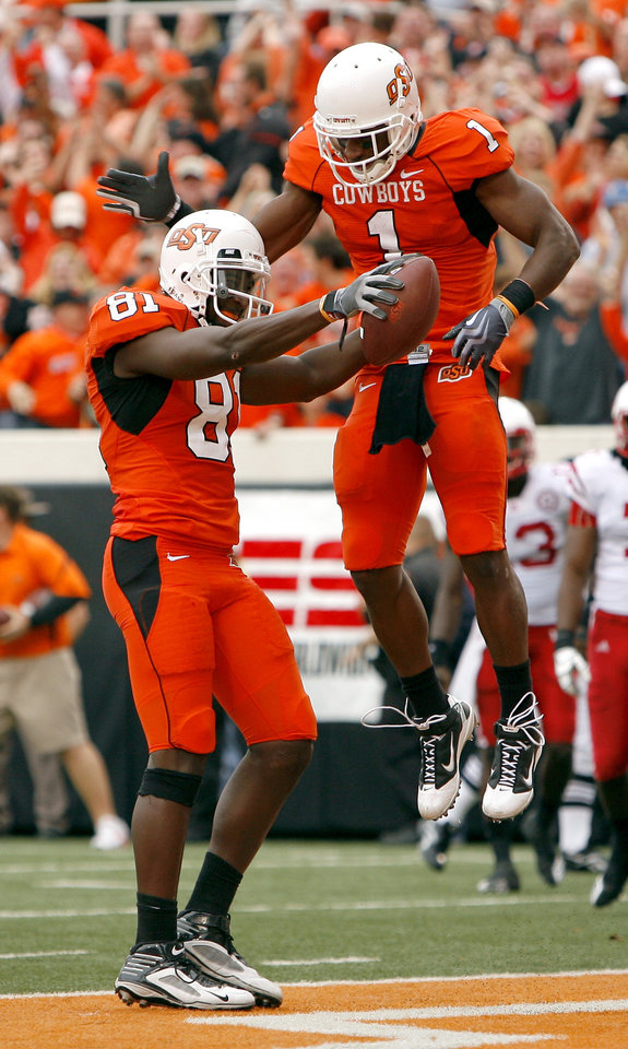 Photo - OSU's Justin Blackmon (87) and Joseph Randle (1) celebrate a touchdown during the college football game between the Oklahoma State Cowboys (OSU) and the Nebraska Huskers (NU) at Boone Pickens Stadium in Stillwater, Okla., Saturday, Oct. 23, 2010. Photo by Sarah Phipps, The Oklahoman