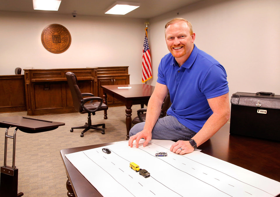 Photo -  Oklahoma City personal injury attorney Chris Hammons poses in the mock courtroom that he designed as part of his firm's new office building at 1332 SW 89. [PHOTO BY JIM BECKEL, THE OKLAHOMAN]