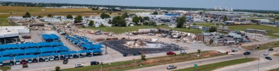 Photo -  This drone image shows the tornado damage trail leading from Skyview Estates Manufactured Home Community, left rear, directly to the American Budget Value Inn in El Reno. [Dave Morris/The Oklahoman]