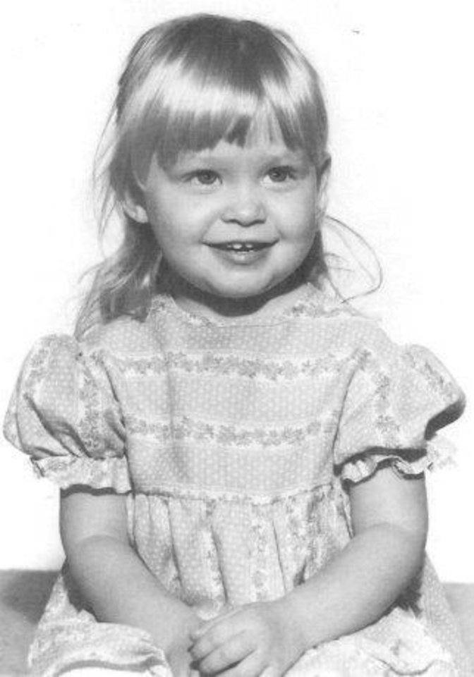 Photo -  The FBI last year released this childhood picture of Suzanne Marie Sevakis near the time she was kidnapped by Franklin Delano Floyd in the 1970s. He raised her as a daughter then married her in 1989. She was working as a stripper in Tulsa when she died in a hit-and-run incident during a visit to Oklahoma City in 1990. She was 20 at the time of her death.
