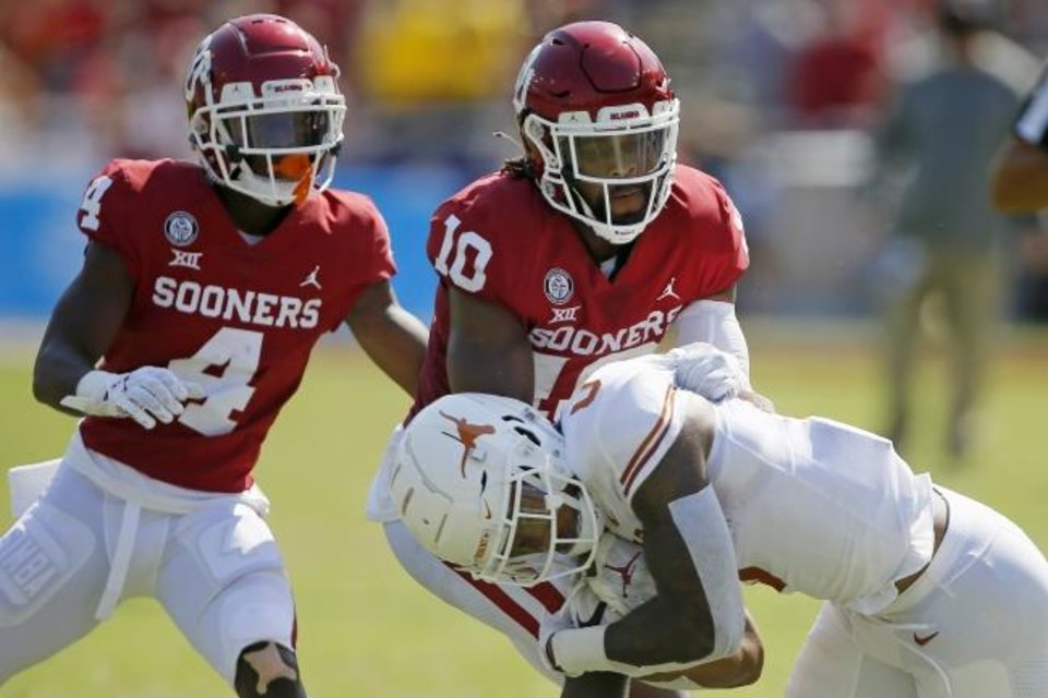 Photo -  OU safety Pat Fields (10) brings down Texas receiver Tarik Black (0) during the Sooners' 53-45 win on Oct. 10 in Dallas. [Bryan Terry/The Oklahoman]