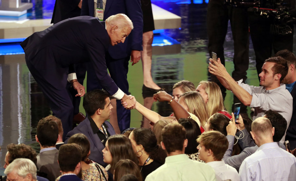 Photo - Democratic presidential candidate former vice president Joe Biden greets supporter after the Democratic primary debate hosted by NBC News at the Adrienne Arsht Center for the Performing Art, Thursday, June 27, 2019, in Miami. (AP Photo/Wilfredo Lee)