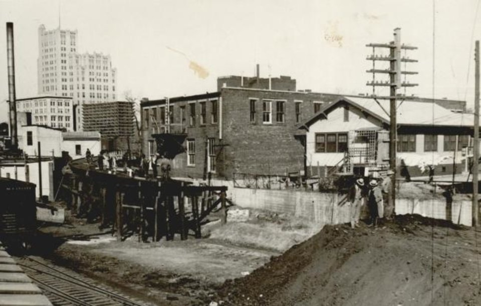 Photo -  Crews build a link between the Rock Island freight yard on Bricktown's north side and the elevated Santa Fe tracks. [THE OKLAHOMAN ARCHIVES]