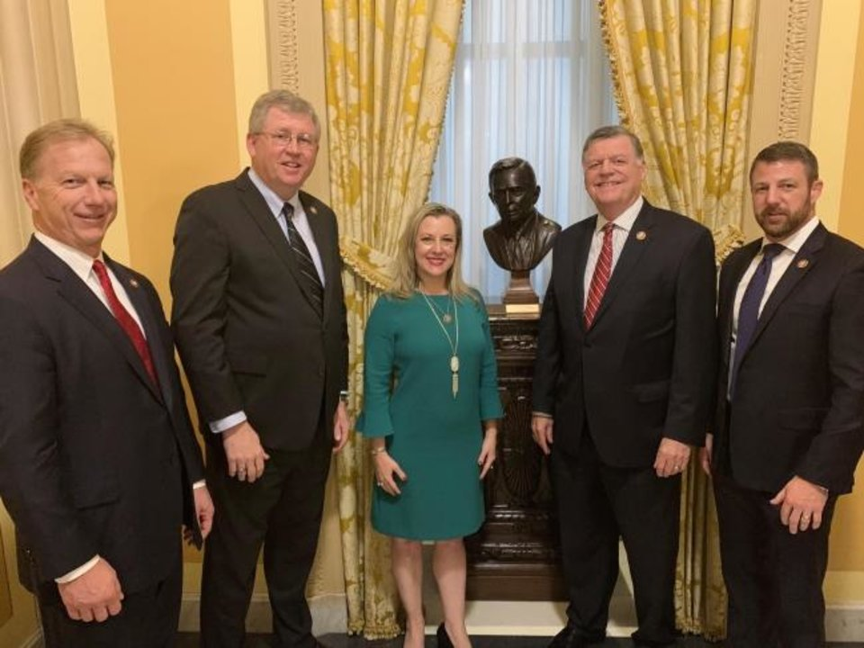 Photo - U.S. Reps. Kevin Hern, R-Tulsa; Frank Lucas, R-Cheyenne; Kendra Horn, D-Oklahoma City; Tom Cole, R-Moore; and Markwayne Mullin, R-Westville stand by a bust of former U.S. House Speaker Carl Albert on Monday in the U.S. Capitol. [Photo provided]
