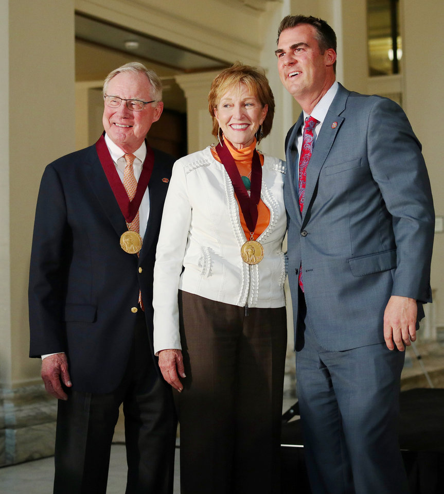 Photo - OSU President Burns Hargis and his wife, Ann pose with  Governor Kevin Stitt at the Governor's Arts Awards at the Capitol, Tuesday, April 16, 2019. Photo by Doug Hoke/The Oklahoman