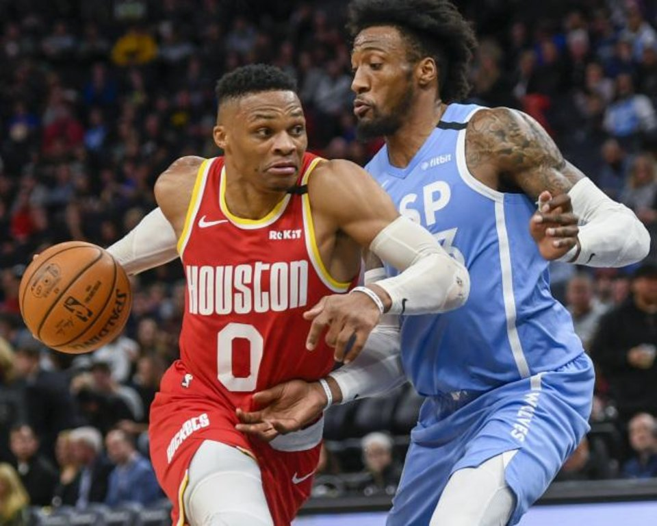 Photo -  Houston Rockets guard Russell Westbrook, left, drives past Minnesota Timberwolves guard Jarrett Culver during Friday night's game  in Minneapolis. Westbrook scored 45 points as Houston won 131-124. [AP Photo/Craig Lassig]