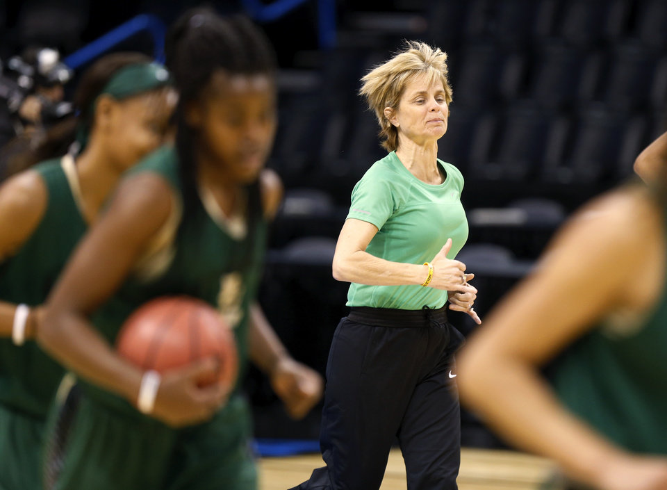 Photo - Baylor coach Kim Mulkey runs to the middle of the court with her players during the first practice day for the Oklahoma City Regional in the NCAA Division I Women's Basketball Championship at Chesapeake Energy Arena in Oklahoma City, Thursday, March 26, 2015. Photo by Nate Billings, The Oklahoman