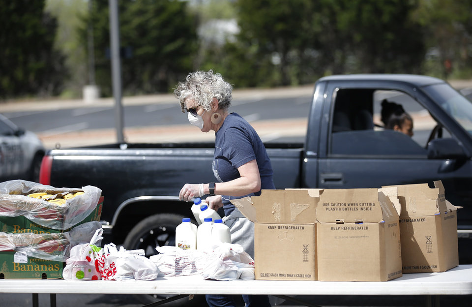 Photo - at PeopleÕs Church, 800 E. Britton Rd., in Oklahoma City, Thursday, April 9, 2020. Cars lined up for miles for hours as the church members gave away 6,000 pounds of free groceries and supplies. [Sarah Phipps/The Oklahoman]
