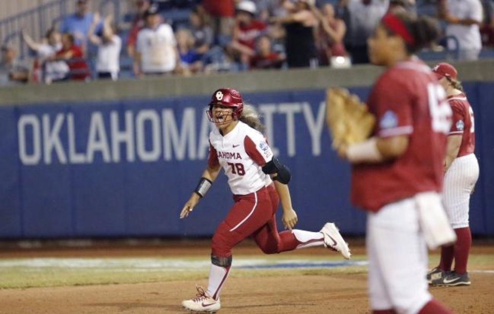 Photo -  OU Jocelyn Alo (78) celebrates her home run in the fifth inning against Alabama last June in the Women's College World Series at USA Softball Hall of Fame Stadium. The Women's College World Series was set to return to Oklahoma City on May 28 but was canceled as a result of the coronavirus pandemic, denying the city millions in revenue. [Sarah Phipps/The Oklahoman]