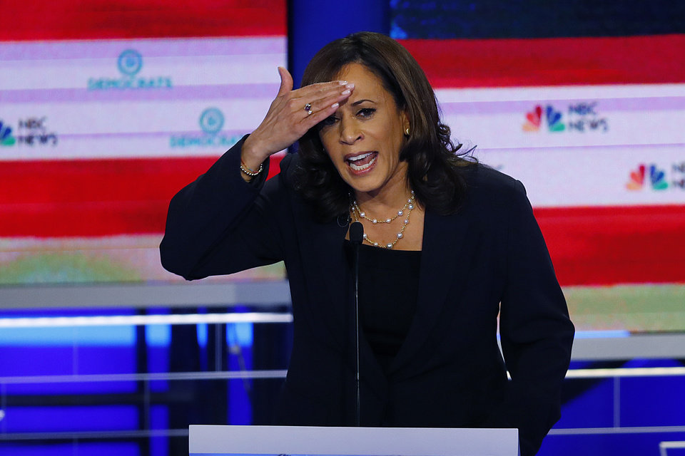 Photo - Democratic presidential candidate Sen. Kamala Harris, D-Calif., gestures during the Democratic primary debate hosted by NBC News at the Adrienne Arsht Center for the Performing Art, Thursday, June 27, 2019, in Miami. (AP Photo/Wilfredo Lee)