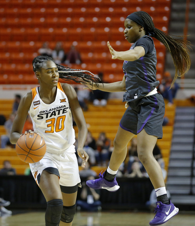 Photo - Oklahoma State's Sara Rodrigues (30) goes past TCU's Ryann Payne (1) during a women's NCAA basketball game between the Oklahoma State University Cowgirls (OSU) and the TCU Horned Frogs at Gallagher-Iba Arena in Stillwater, Okla., Wednesday, Jan. 29, 2020. Oklahoma State lost 72-68. [Bryan Terry/The Oklahoman]
