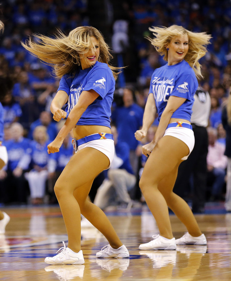 Photo - The Thunder Girls dance during Game 5 of the first round series between the Oklahoma City Thunder and the Dallas Mavericks in the NBA playoffs at Chesapeake Energy Arena in Oklahoma City, Monday, April 25, 2016. Photo by Nate Billings, The Oklahoman