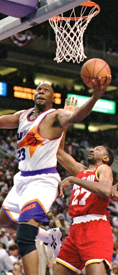 Photo - Phoenix Suns Wayman Tisdale goes to the basket in front of Houston Rockets Charles Jones in the fourth quarter of their NBA basketball playoff game in Phoenix Tuesday May 9, 1995. Phoenix defeated Houston 130-108.   FIRST, B&W, PAGE 28, M11 WAYMAN