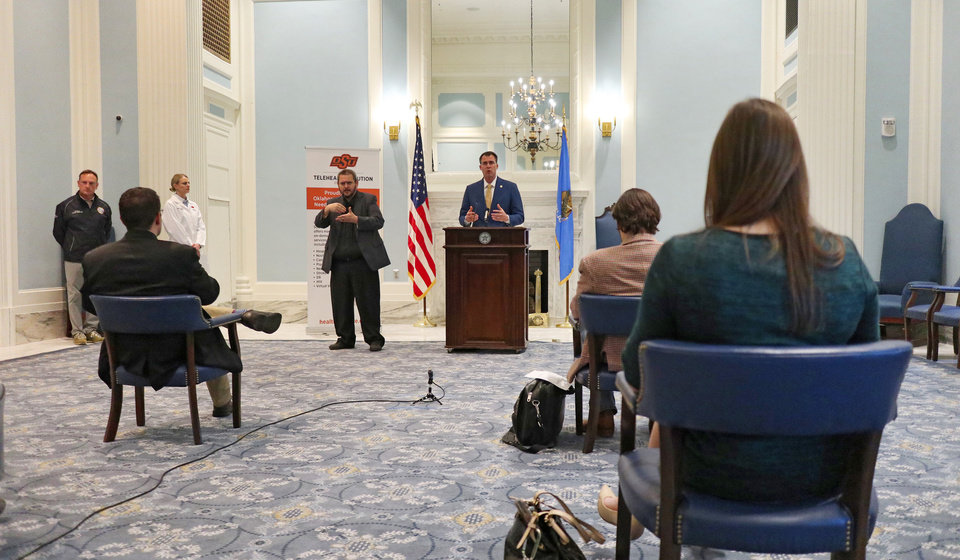 Photo - Gov. Kevin Stitt addresses the the media during a briefing for the Governor's Solution Task Force to provide an update on Oklahoma's COVID-19 response in the Blue Room of the Capitol Wednesday, April 15, 2020.  [Photo by Doug Hoke/The Oklahoman]
