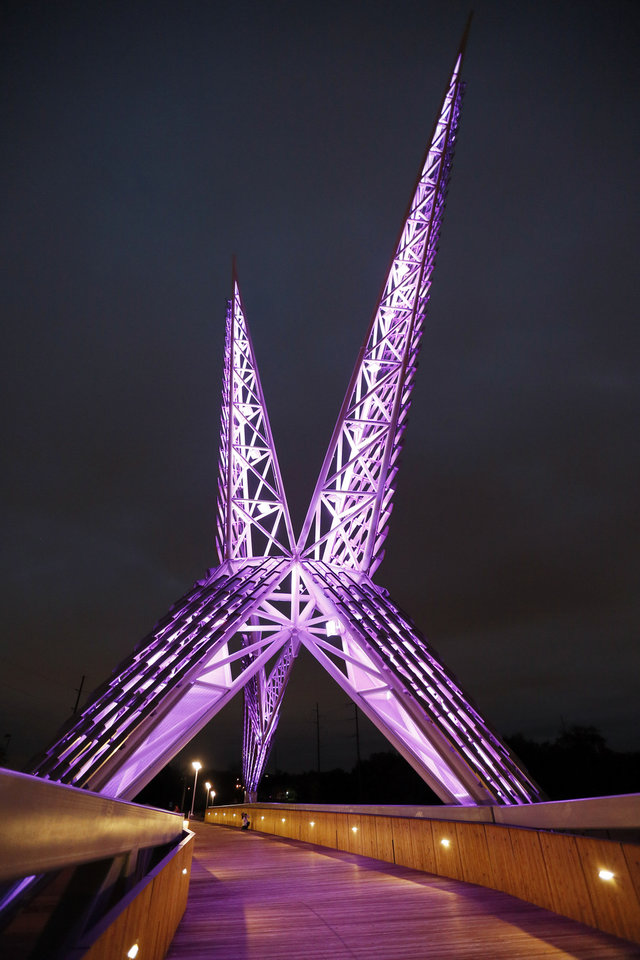 Photo - The SkyDance Bridge glows purple in downtown Oklahoma City. [The Oklahoman Archives]