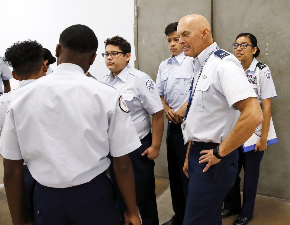 Photo -  Col. Bill Tully talks to cadets before drill practice in the Crooked Oak High School Air Force JROTC building. [Photo by Nate Billings, The Oklahoman]