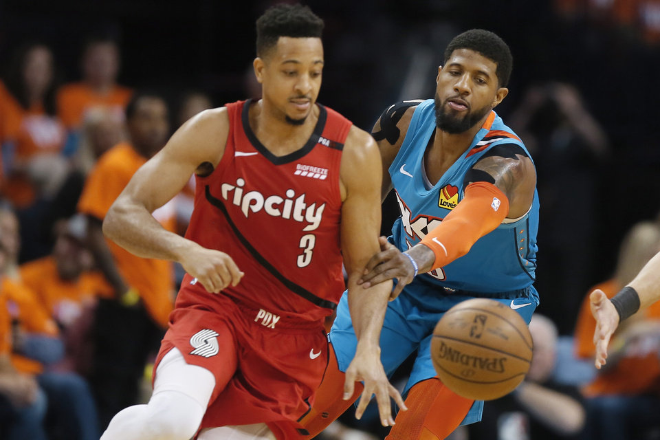 Photo - Oklahoma City's Paul George (13) knocks the ball away from Portland's CJ McCollum (3) during Game 3 in the first round of the NBA playoffs between the Portland Trail Blazers and the Oklahoma City Thunder at Chesapeake Energy Arena in Oklahoma City, Friday, April 19, 2019. Oklahoma City won 120-108. Photo by Bryan Terry, The Oklahoman
