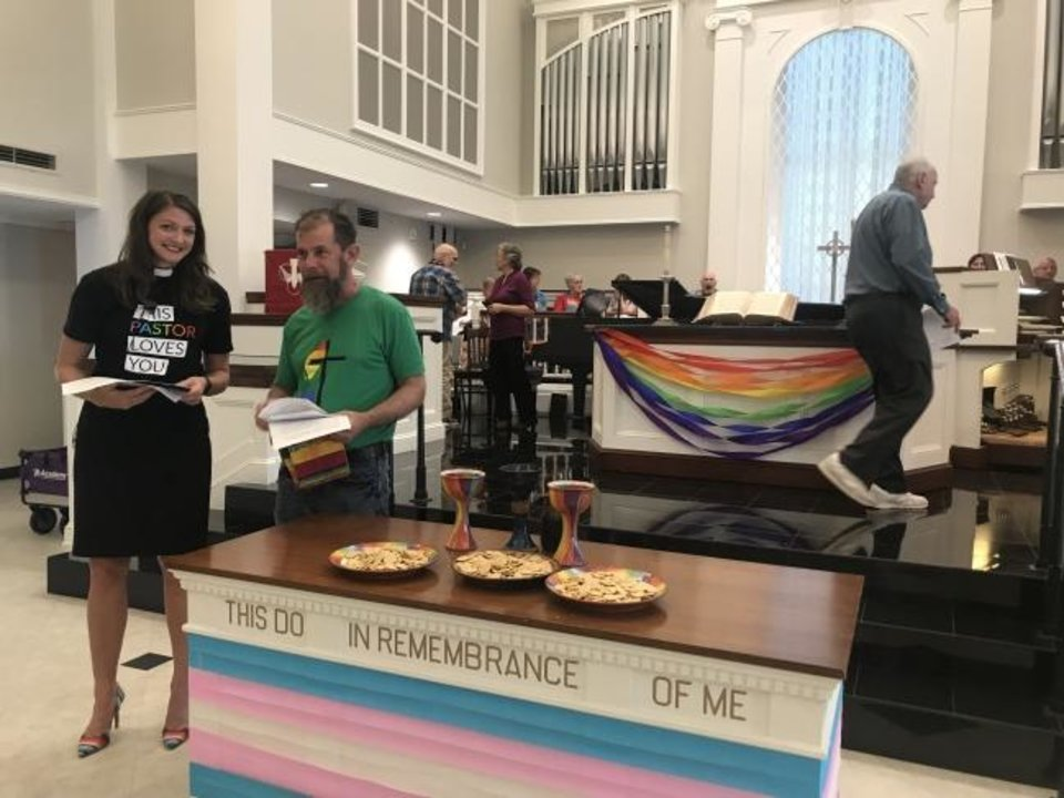 Photo -  The Rev. Lori Walke, associate pastor of Mayflower Congregational Church, and the Rev. Scott Spencer, senior pastor of Mosaic United Methodist Church, talk before the Ecumenical Pride Worship Service on Wednesday at Mayflower Congregational Church-United Church of Christ, 3901 NW 63. [Carla Hinton/The Oklahoman]