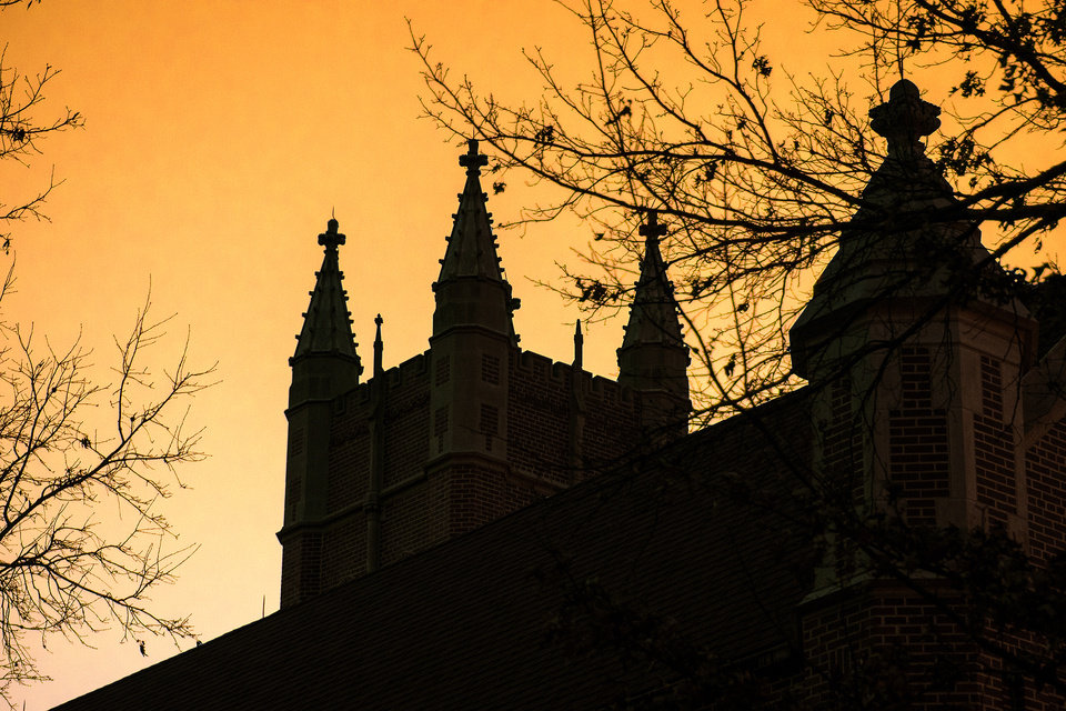 Photo -  St. Gregory's Abbey in Shawnee is shown in silhouette in this photograph. [Photo by Theresa Bragg]
