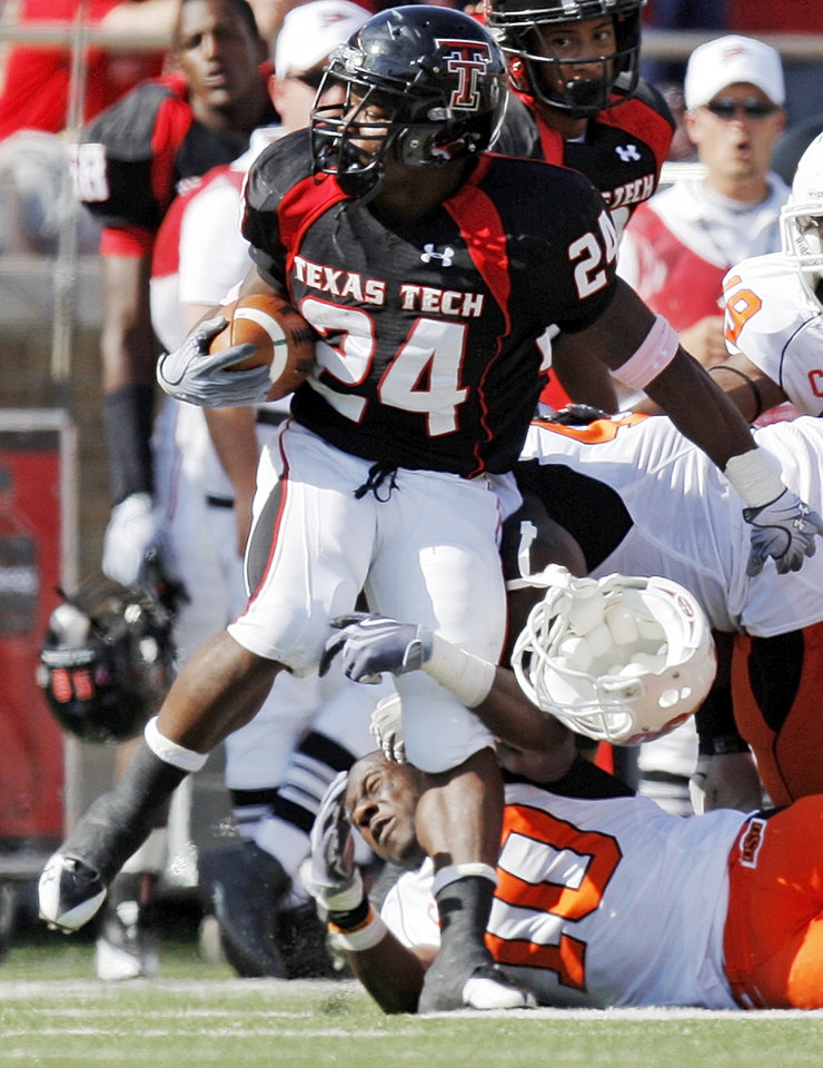 Photo - OSu's Markelle Martin (10) loses his helmet as he tries to tackle Eric Stephens of Texas Tech during the college football game between the Oklahoma State University Cowboys and Texas Tech University Red Raiders at Jones AT&T Stadium in Lubbock, Texas, Saturday, October 16, 2010. Photo by Nate Billings, The Oklahoman