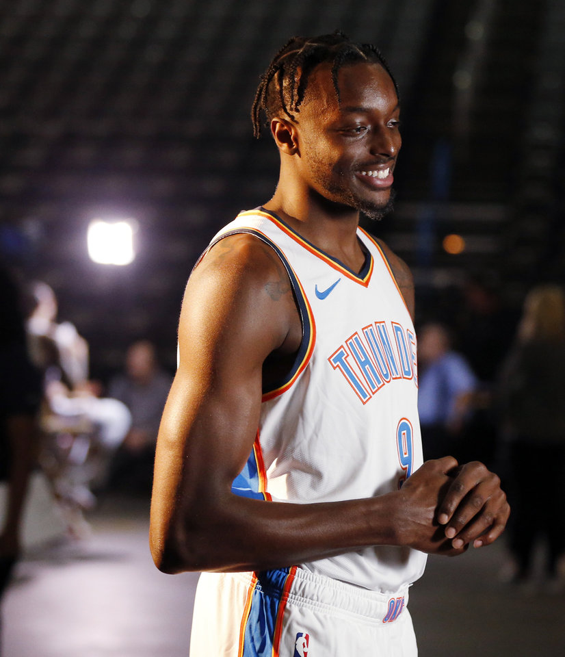 Photo - Jerami Grant gives an interview during media day for the Oklahoma City Thunder at Chesapeake Energy Arena in Oklahoma City, Monday, Sept. 24, 2018. Photo by Nate Billings, The Oklahoman