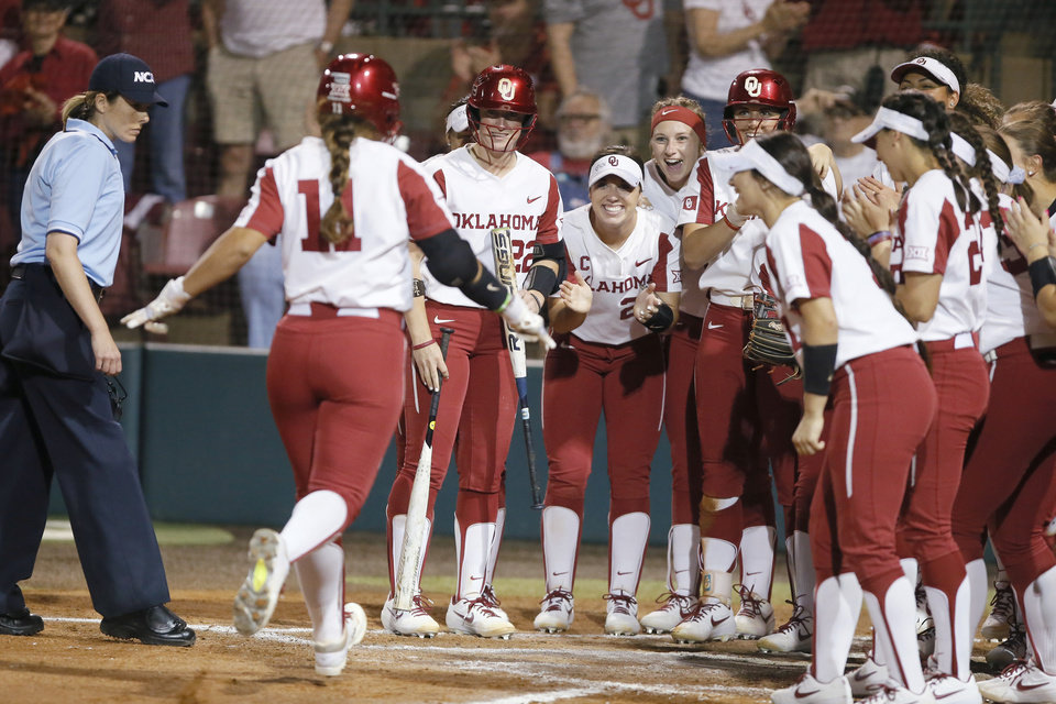 Photo - Oklahoma's Nicole Mendes (11) runs home after hitting a two-run home run in the third inning of the Norman Regional NCAA softball tournament game between the University of Oklahoma (OU) and UMBC in Norman, Okla., Friday, May 17, 2019. Oklahoma won 12-0.  [Bryan Terry/The Oklahoman]