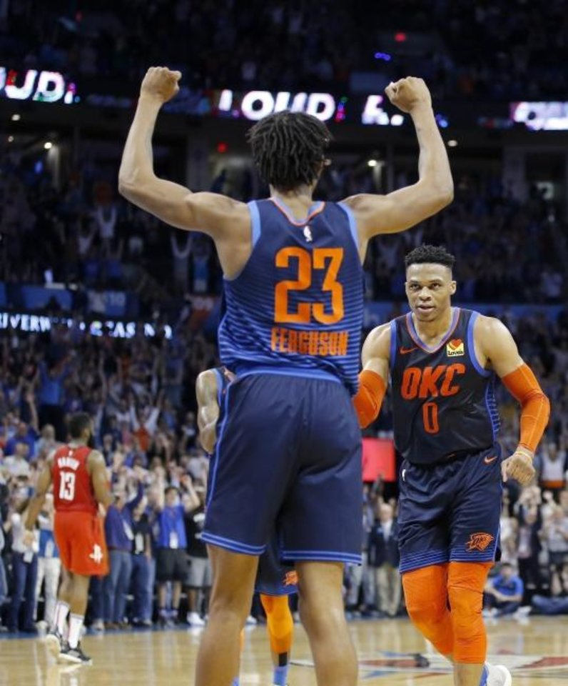 Photo - Oklahoma City's Terrance Ferguson (23) and Russell Westbrook (0) celebrate following the NBA basketball game between the Oklahoma City Thunder and Houston Rockets at the Chesapeake Energy Arena, Tuesday, April 9, 2019. Cowboys won 6-5. Photo by Sarah Phipps, The Oklahoman