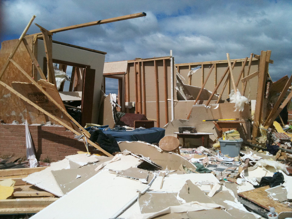 Photo - Storm damage from tornado that went through El Reno Tuesday, May 24, 2011. Photo by Chris Landsberger, The Oklahoman