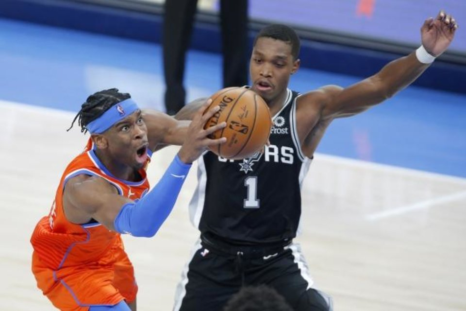 Photo -  Oklahoma City's Shai Gilgeous-Alexander (2) goes past San Antonio's Lonnie Walker IV (1) during an NBA basketball game between the Oklahoma City Thunder and the San Antonio Spurs at Chesapeake Energy Arena in Oklahoma City, Tuesday, Jan. 12, 2021. [Bryan Terry/The Oklahoman]